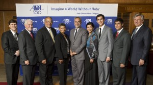 From left, ADL Connecticut Regional Director Gary Jones, University of Hartford President Dr. Walter Harrison, Deacon Arthur Miller, Sandra Miller, Dr. M. Saud Anwar, Dr. Yusra Anwar, Taha Anwar, Taseen Anwar, ADL Hartford County Chair Gary Greenberg